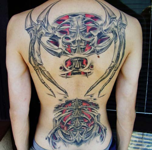 https://i0.wp.com/www.orangeinks.com/wp-content/uploads/2008/06/cool-biomech-tattoo-back-design.jpg