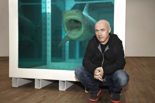 Damien Hirst poses in front of his famous shark/Tate Modern