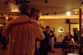 A beautiful example of the tango downward gaze while locked in close embrace.