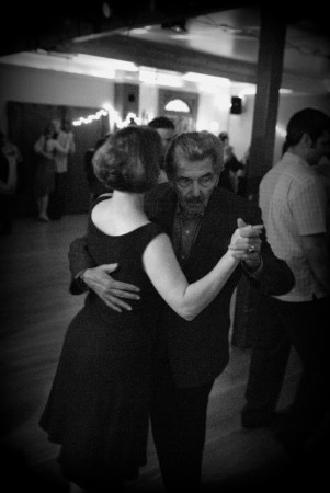 Milonga night, a couple engrossed in the moment and the music.