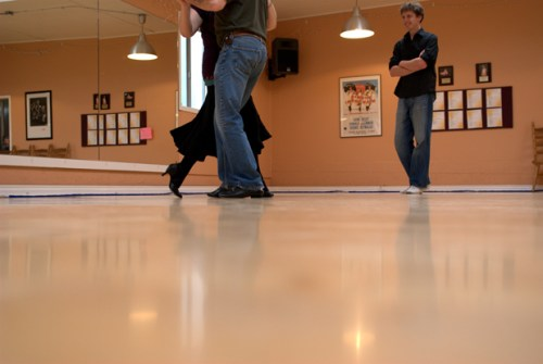 Tango teacher, Mike Eblen instructs an intermediate-level pair at SE Portland's Dance with Joy Studios.