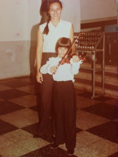 Young fiddler Ines Voglar with her teacher.