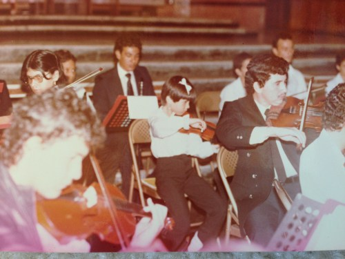 Oregon Symphony violinist Ines Voglar performing in the Youth Orchestra of Venezuela, 198?