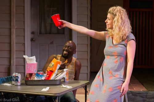 "Brooke Totman toasts the company in ""Detroit"" at Portland Playhouse."