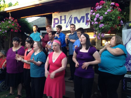 Abbi Dunham (right, in purple blouse) sings with the PHAME choir.
