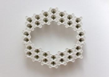 "Kristina Lewis, Portal, 2014. Cartons, papier-mâché, epoxy clay, acrylic, 21"" x 22"" x 3"""