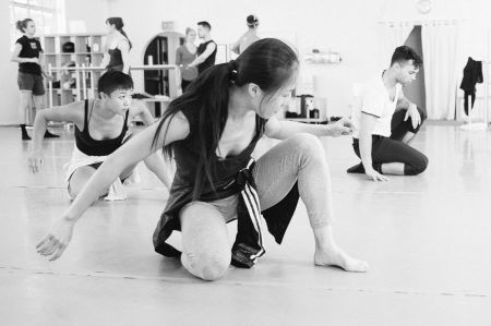 Yin Yue (center) rehearsing Ching Ching Wong and Viktor Usov. Photo: NW Dance Project
