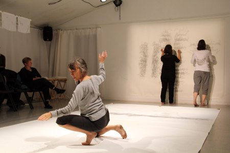 Linda Austin dances while Pat Boas and Linda Hutchins attack the wall./Photo by Chelsea Petrakis