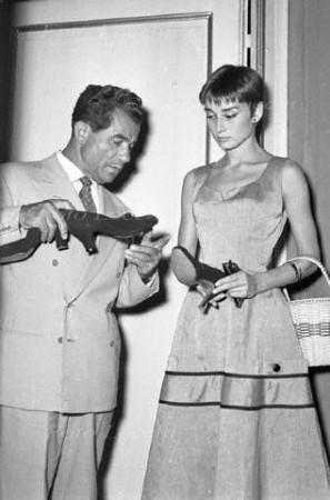 Audrey Hepburn examining Ferragamo shoe. Foto Locchi; courtesy Banca Dali dell'Archivio Storico Foto Locchi Firenze.