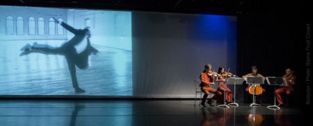 Hampton on screen, musicians onstage. Photo: Blaine Truitt Covert