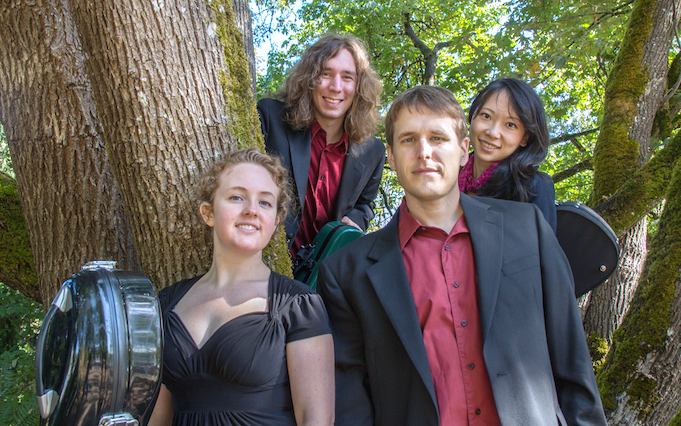 Photo Header: Caption: Delgani String Quartet with Kelly Quesada (cello), Morgan O'Shaughnessey (violin), Wyatt True (violin), and Jannie Wei (violin).