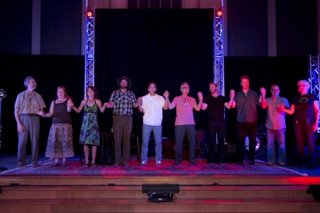 Tellers and band take a post-show bow. Photo: Mike Bodine