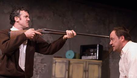 "John Steinkamp takes aim on Tim True in ""The Lonesome West""/Owen Carey"