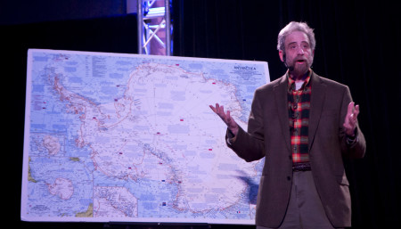 Lawrence Howard, onstage with a map of Antarctica. Photo: Mike Bodine