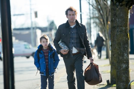 "Jaeden Lieberher and Clive Owen in ""The Confirmation."""