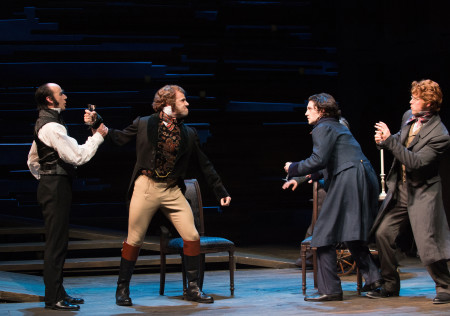 Mr. Jaggers (Michael Elich) prevents Bentley Drummle (Daniel Duque-Estrada) from fighting with Pip (Benjamin Bonenfant) and Herbert Pocket (Dylan Paul). Photo by Jenny Graham, Oregon Shakespeare Festival.