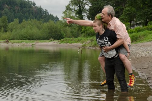 The two character known as George – Rabbit carrying Tim Stapleton – during a workshop on the Sandy River. Photo: Brent Barnett