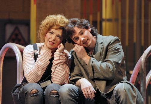 Tatiana (Jennifer Forni) and Eugene Onegin (Alexander Elliot) share headphones/Photo by Cory Weaver.