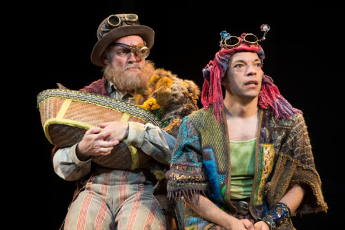 The Old Shepherd (Jonathan Haugen) and his son (Paco Tolson) with the basket in which they found the infant Perdita. Photo: Jenny Graham, Oregon Shakespeare Festival