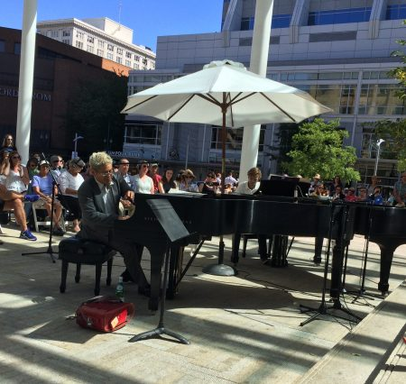 Pink Martini's Thomas Lauderdale (l) joined Hunter Noack at the other piano in the landscape of Portland's Director Park.