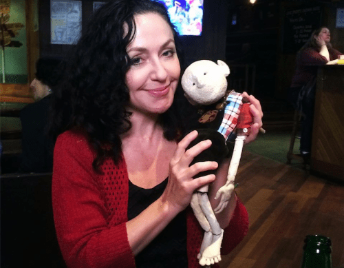 "Rene Denfeld in Edinburgh with a puppet from  the group Pharmacy's stage adaptation of her novel ""The Enchanted."""