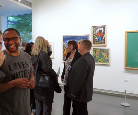 Collector and guest curator John Goodwin (in foreground) on opening night/ Courtesy Upfor