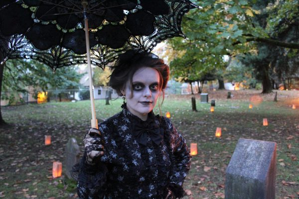 Local actor Emily Mercer leads the way into a ghostly adventure at the Lone Fir Cemetery.