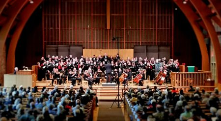 Ethan Sperry led Oregon Repertory Singers and Vancouver Symphony Orchestra. Photo: Allison Silverberg.
