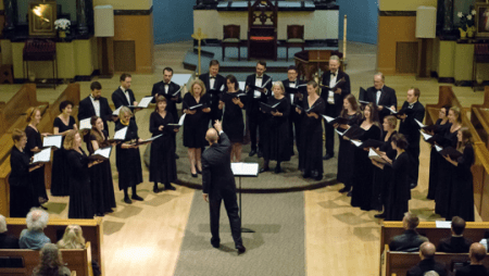 Blake Applegate leads Cantores in Ecclesia.