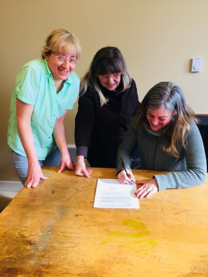 Agnes Field, Brenda Harper, and Jessica Schleif signing of MOU