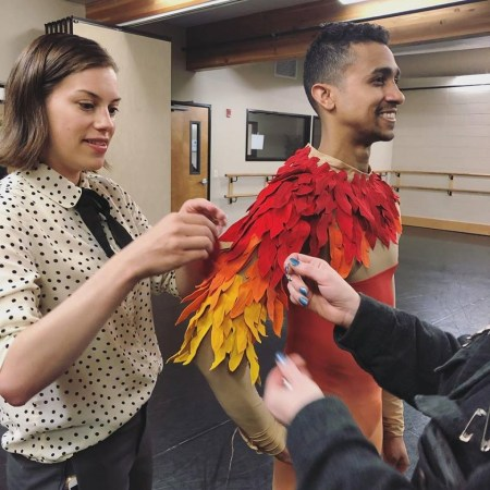 Designer Susan Roemer fits Yamil Maldonado in one third of the Firebird costume. Photo courtesy of Suzanne Haag