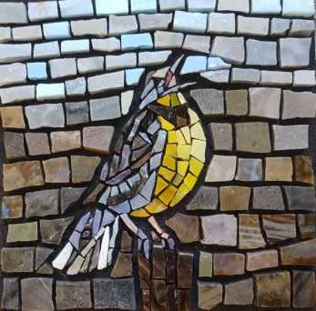 Mosaic artist Joanne Daschel works in glass and stone tiles to create art on themes including garden, food, landscape, and nature, such as this western meadowlark.