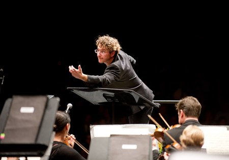 Teddy Abrams conducting Louisville Orchestra. Photo by O'Neil Arnold.