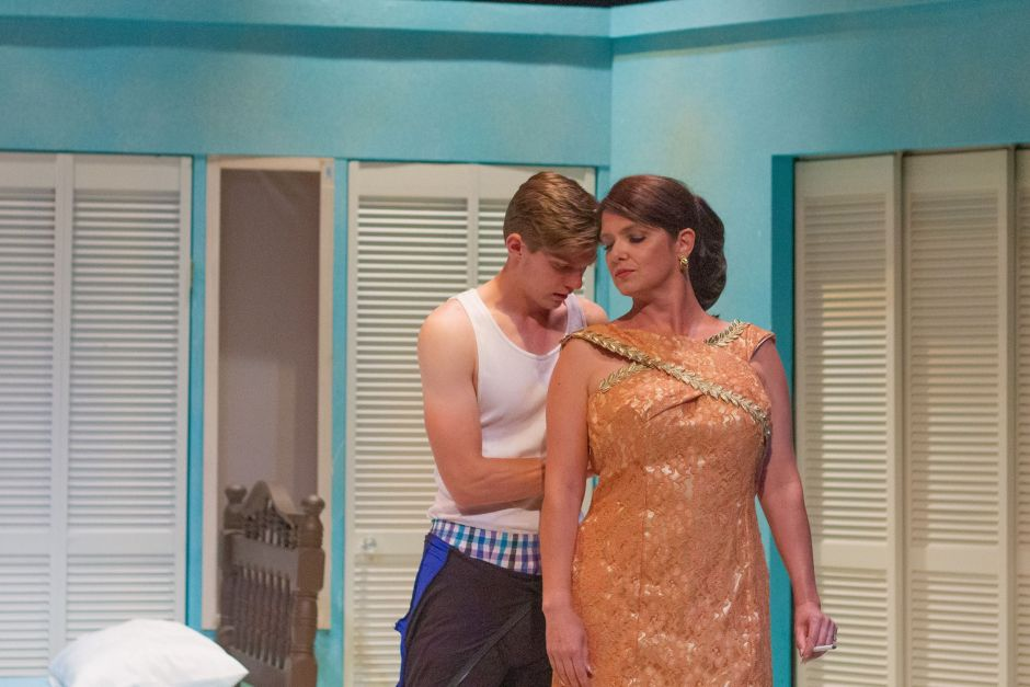 """Benjamin Braddock (John Davis Jr.) decides to follow the lead of Mrs. Robinson (Holly Spencer) in Gallery Theater's production of """"The Graduate,"""" which opens Friday, July 26, in McMinnville. Photo by: EKay Media, courtesy Gallery Theater"""
