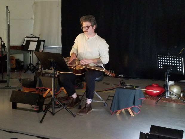 Caspar Sonnet performs Lo Wie's 'Score for 3 Performers' at Extradition's summer concert. Photo by Glenn Sogge.