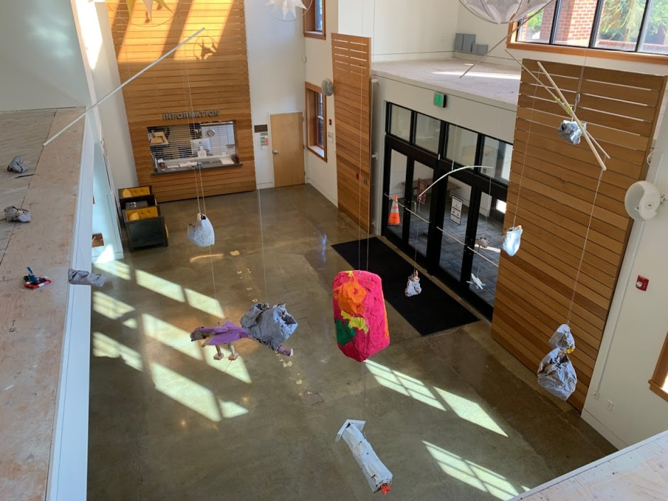"""A red planet of continents and lava is a centerpiece of """"Finn Builds a Galaxy"""" at the Chehalem Cultural Center. Photo courtesy: Artist Michael Bernard Stevenson Jr."""