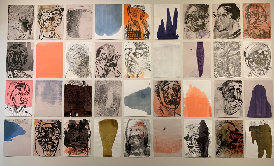 """Cadre,"" by Storm Tharp, fills a wall with 36 images, most of them portraits, on paper in a grid. Photo by: David Bates"