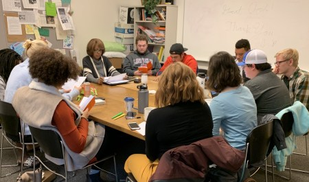 "Director Adleane Hunter and the cast of Linfield Theatre's production of ""Sweat"" gathered earlier this fall for the first table-read. Photo by: David Bates"