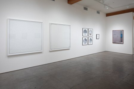 Photo of minimalist two-dimensional artworks in a contemporary gallery space