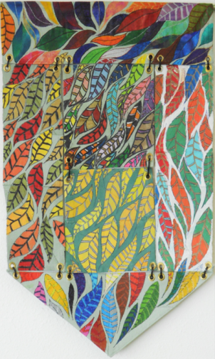 A team of students made this banner for the Nye Beach Banner Project. Each student filled filled in the feather images on one of six swatches, then drew their own picture on the opposite side. The fabric pieces were then grommeted together to form the banner.