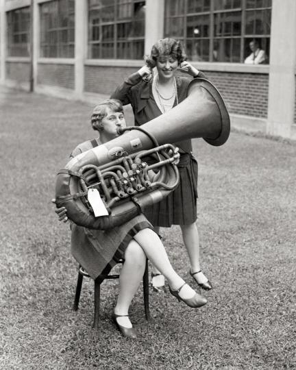 Girl playing tuba,  postcard, 1928