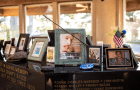 """A plinth inside the sanctuary, """"Dedicated in loving memory of Lincoln County based fishermen lost at sea since 1900,"""" serves as a base for photos, candles, and other remembrances of lost sailors. Many of the mementos were damaged in last month's vandalism. Photo courtesy: Newport Fishermen's Wives"""
