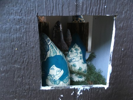 blue-and-white ceramics in a chicken coop nesting box