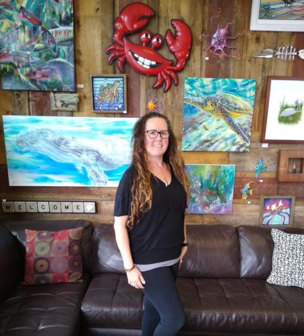 Kim McLaughlin and her husband, Gary Manos, are moving their Laughing Crab Gallery from downtown Yachats to downtown Florence. Photo by: Cheryl Romano/YachatsNews.com