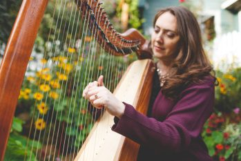 """Bethany Lee says when she plays harp for hospice patients, """"watching them come to rest because of music that I'm offering -- it's pretty powerful and amazing to see."""" Photo by: Bee Joy España"""