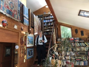 Theresa McCracken, with the help of friends, built her Waldport home and has filled it with mementos of her travels around much of the world. Photo by: Quinton Smith/YachatsNews.com