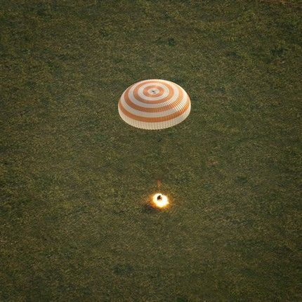 The Soyuz TMA-15M spacecraft is seen as it lands with Expedition 43 commander Terry Virts of NASA, cosmonaut Anton Shkaplerov of the Russian Federal Space Agency (Roscosmos), and Italian astronaut Samantha Cristoforetti from European Space Agency (ESA) near the town of Zhezkazgan, Kazakhstan on Thursday, June 11, 2015. Virtz, Shkaplerov, and Cristoforetti are returning after more than six months onboard the International Space Station where they served as members of the Expedition 42 and 43 crews. Photo Credit: (NASA/Bill Ingalls)