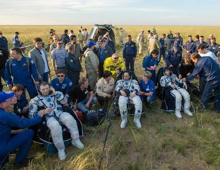 Expedition 43 commander Terry Virts of NASA, left, cosmonaut Anton Shkaplerov of the Russian Federal Space Agency (Roscosmos), center, and Italian astronaut Samantha Cristoforetti from European Space Agency (ESA) sit in chairs outside the Soyuz TMA-15M spacecraft just minutes after they landed in a remote area near the town of Zhezkazgan, Kazakhstan on Thursday, June 11, 2015. Virts, Shkaplerov, and Cristoforetti are returning after more than six months onboard the International Space Station where they served as members of the Expedition 42 and 43 crews. Photo Credit: (NASA/Bill Ingalls)