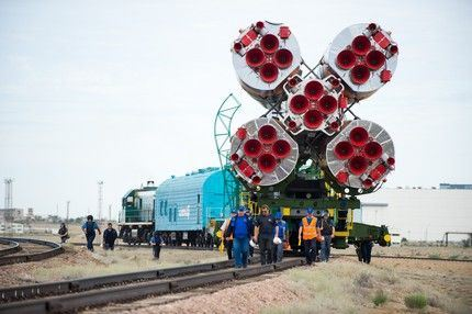 The Soyuz TMA-17M spacecraft is rolled out to the launch pad by train on Monday, July 20, 2015 at the Baikonur Cosmodrome in Kazakhstan.  Launch of the Soyuz rocket is scheduled for July 23 and will carry Expedition 44 Soyuz Commander Oleg Kononenko of the Russian Federal Space Agency (Roscosmos), Flight Engineer Kjell Lindgren of NASA, and Flight Engineer Kimiya Yui of the Japan Aerospace Exploration Agency (JAXA) into orbit to begin their five month mission on the International Space Station. Photo Credit: (NASA/Aubrey Gemignani)