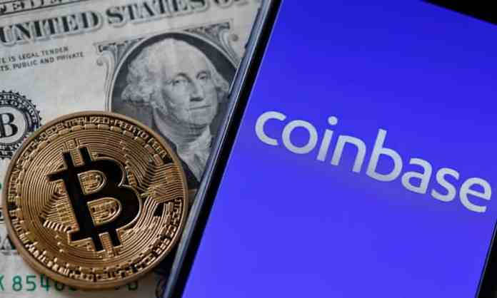 Picture of a mobile phone with Coinbase open on it, with a bitcoin and a dollar bill next to it